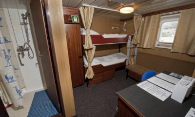 Twin cabin, with private facilities and window.