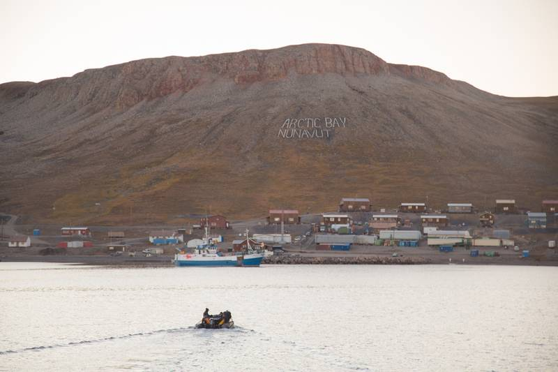 Zodiac to small village, Northwest passage cruise