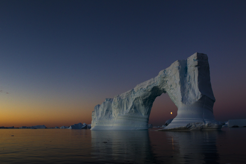 Antarctic iceberg in twilight with moon, Antarctica cruise