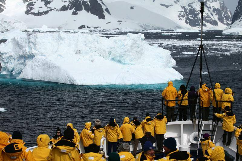 Antarctica tourists on bow of ship, Cruise to Antarctica