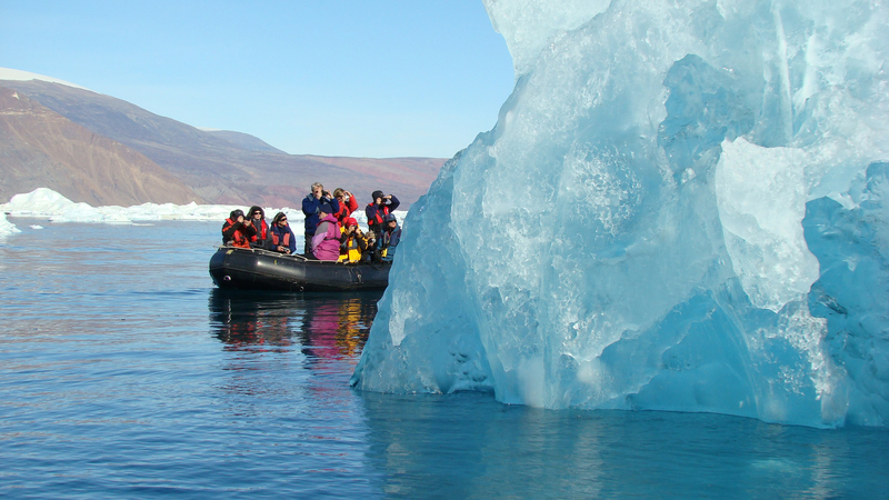 Zodiac and ice berg, Arctic cruise