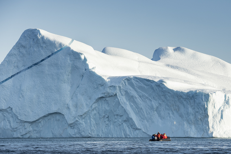 Zodiac cruise beneath huge iceberg, Arctic cruise