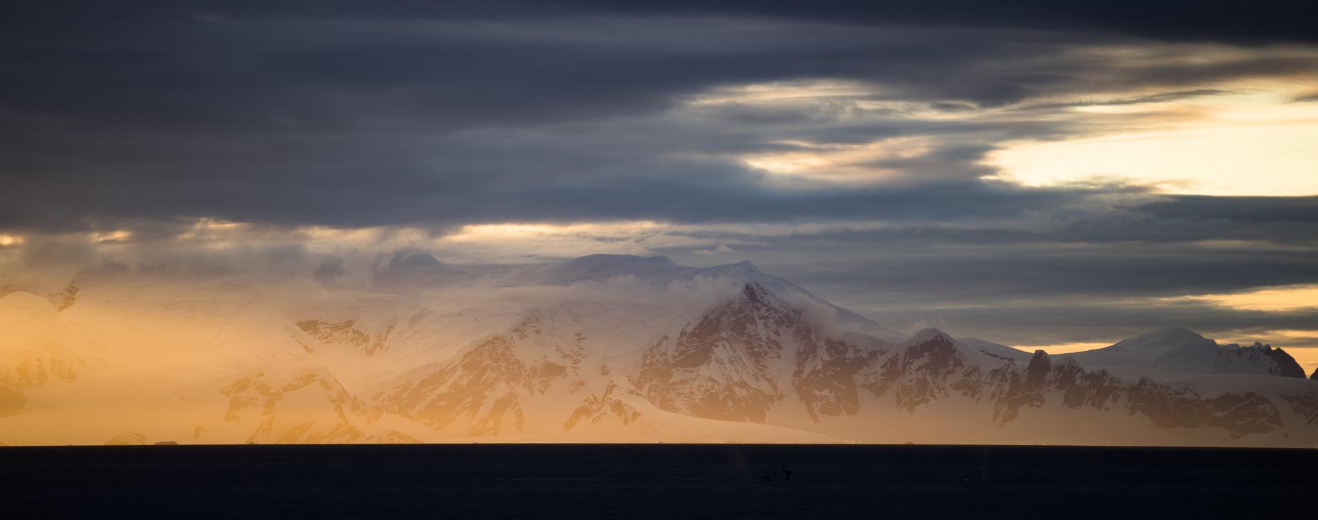 Antarctica sunset and mountains