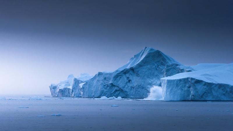 Calving iceberg in the blue hour gn stian klo